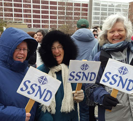 Provincial Council leaders in a peaceful march, holding up SSND signs