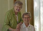 Sisters Ancilla Marie Roussel (L) and Marie Andre Miszewski (R) join together to say fairwell to St. Mary of the Pines in Chatawa, Mississippi in 2019.
