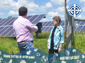 Sister Margie Klein and Bill Ward, the Facilities Manager at OLGC, talking at the solar garden located at Our Lady of Good Counsel, Mankato, Minnesota.