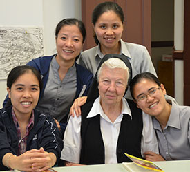 S. Marie Clare Powell with vietnamese visiting sisters for the Amazon Smile photograph