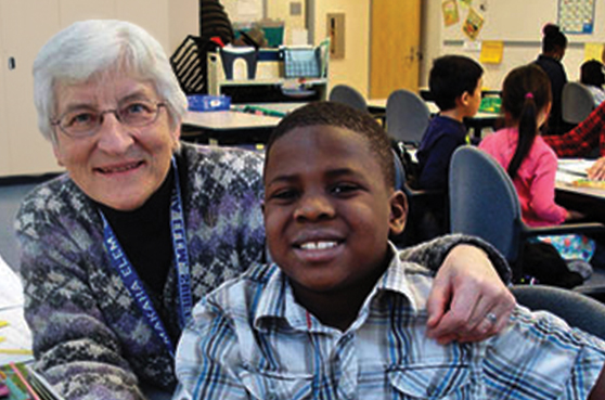 Sister Audrey Lindenfelser with a student at East Side Learning Center in St. Paul, Minnesota.