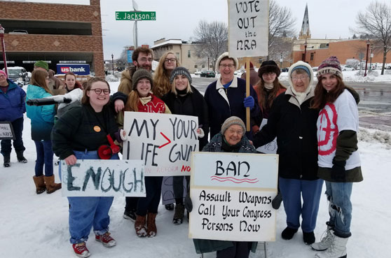 Sisters Mary Anne Owens and Alice Zachmann (back row amongst the young protestor organizers) Sister Gladys Schmitz (sits in the chair in front of the group) joined the marchers for the final rally at the end of the March for our Lives event.