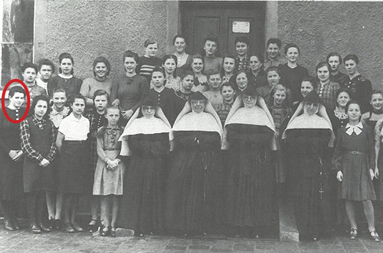 Sister Carol Marie Wildt gave a presentation about Sister mary Imma Mack. The photo has Sister Mary Imma with children and sisters at a Children's Home in Freising, Germany.