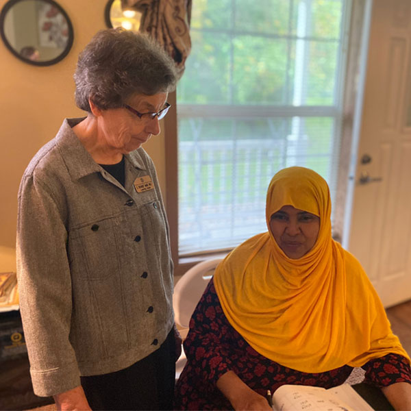Sister Richarde' Marie Wolf, coordinator of the Refugee Outreach Program, helps tutor adult women at Good Counsel Learning Center and in their homes.