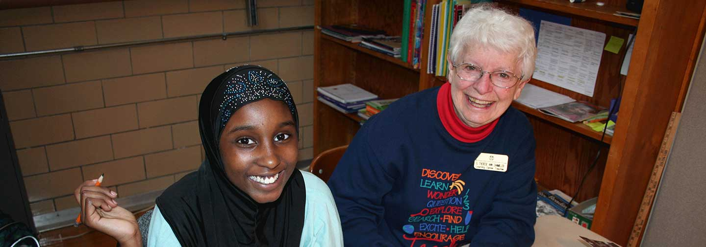Sister Therese Ann Zanmiller and Samaya work on her writing skills at the Good Counsel Learning Center on April 27, 2017.