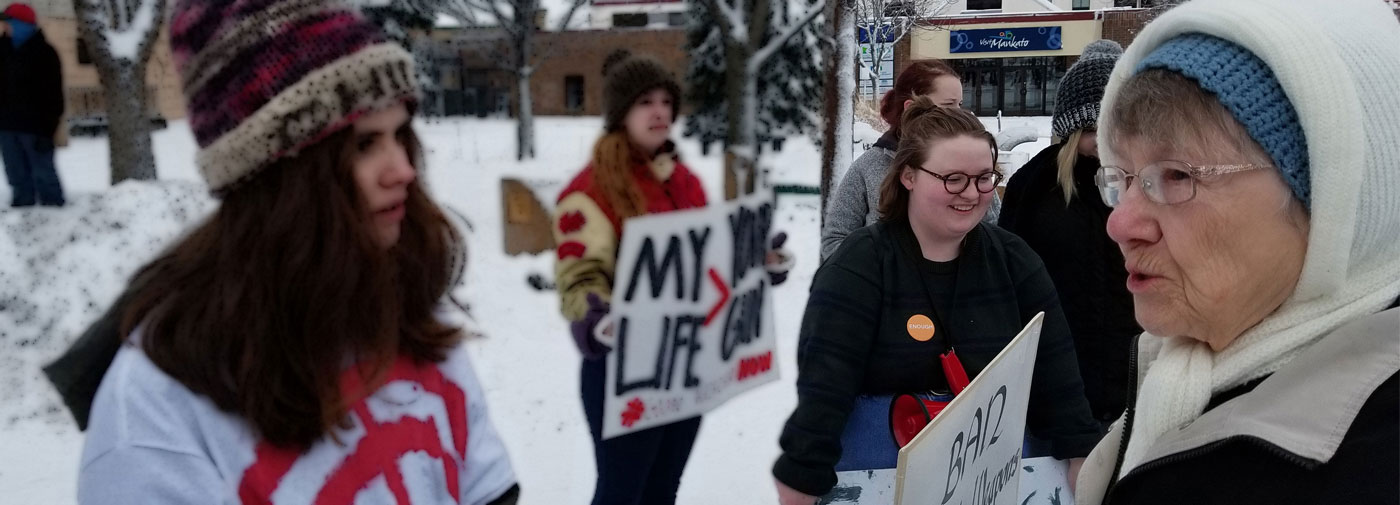 S. Alice Zachmann talking with the organizers of March for Our Lives.