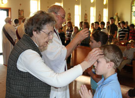 A student receives ashes on Ash Wednesday in Milwaukee.
