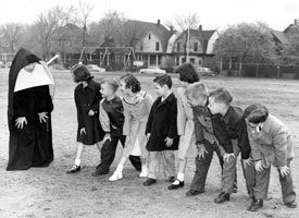 A sister prepares for a race with students in Milwaukee.