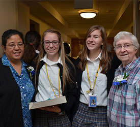 Two sisters and two Notre Dame High School in St. Louis students.
