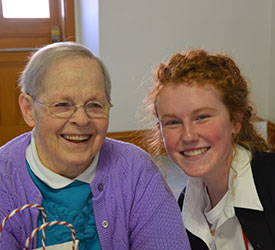 S. Mary Paul Holdmeyer and a Notre Dame High School student pose for a photo.