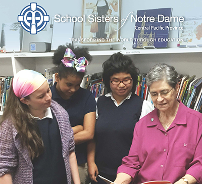 The cover of the 2019 donor newsletter features Sister Georgiann Wildhaber and three students from Notre Dame of Dallas.