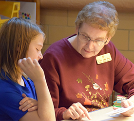 Sister Rita Ann Kipka tutors a fourth grader at Our Lady of Good Counsel's Learning Center in Mankato, Minnesota.