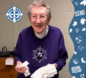 Sister Marie Le Clerc Laux helps make masks from old sheets at Notre Dame of Elm Grove, Elm Grove in Wisconsin. Photo is used for the 2020 Giving Tuesday campaign.