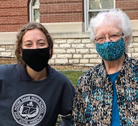 Sister Janice Fennwald and a student from Notre Dame High School in St. Louis gather outside for the Nun Buddy program.