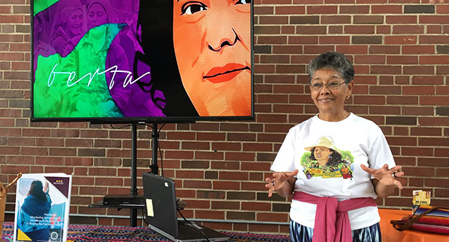 Sister Rosa Maria Trochez, SSND, presenting her call for solidarity to a group of St. Louisians.