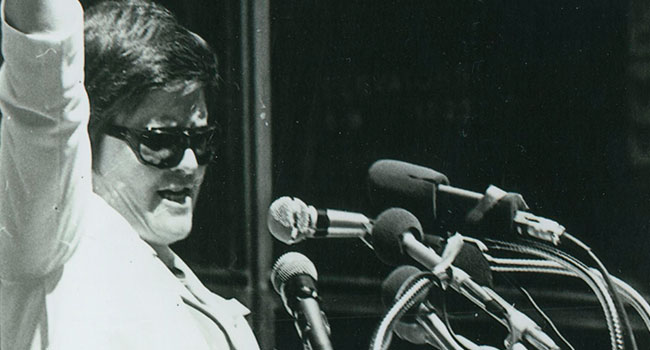 Black and white image of S. Margaret Ellen Traxler talking at a rally