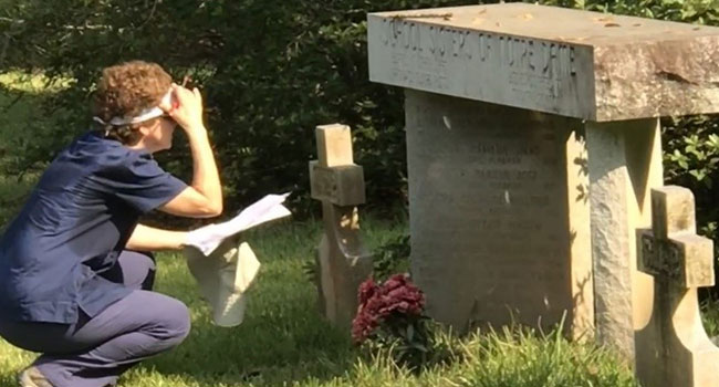 Janice Taulli-Lasseigne reviwing tombstones at the Chatawa Cemetery. Photo by Tina Convington.