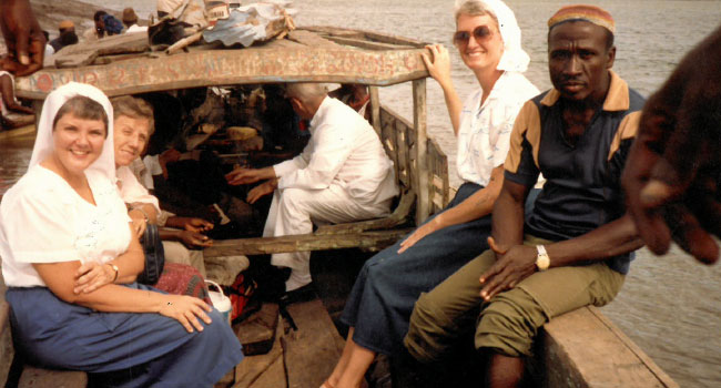 Sister Eleanor Ewerts is on a boat in Sierra Leone during her missions.