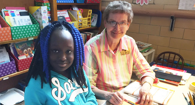 (L to R) Nyanak Deng works with Sister Rita Ann Kipka at the Good Counsel Learning Center.