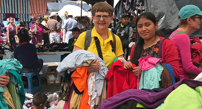 Mariellyn Kuske and her rug hooking partner, Lidia at a market in Guatemala.