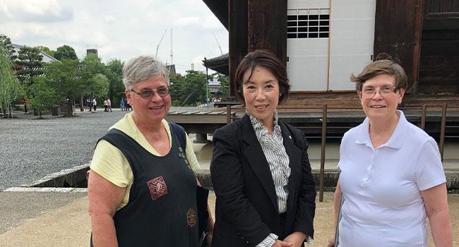 Sister Mary Warner, Associate Ms. Yoshiko Kurimoto, princiapl of Notre Dame Jogkuin High School and S. Linda Marie Bos in Japan.