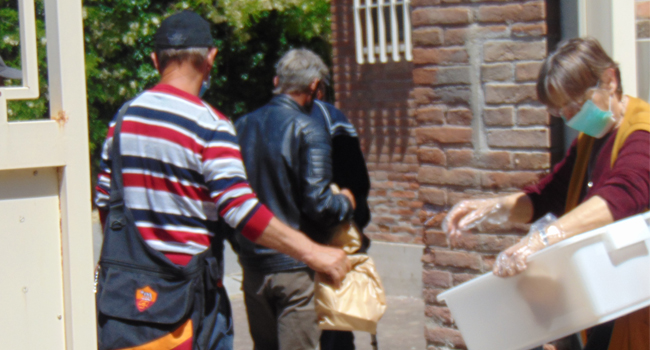 Sisters handed out food to community at the Generalate in Rome during COVID-19.