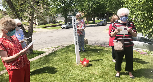 Sisters gather around the Peace Pole at Sister Adaire's home to pray for peace during the race riots in 2020.