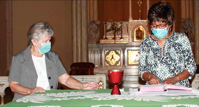 Sister Janice Munier is the first Parish Life Coordinator for the St. Louis Archdiocese. A parishioner and Sister Janice prepare the sacraments.