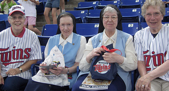 Sisters at a Minnesota Twins game in 2010.