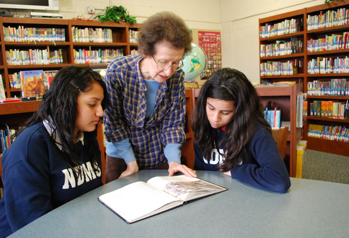 Sister Shannon Marie Scallon working with students at Notre Dame School of Milwaukee