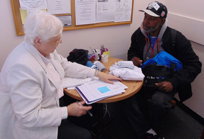Sister Geraldine Neier meets with a client at the Criminal Justice Ministry.