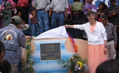 Associate Dianne Henke unveils a plaque commemorating a new water project in Guatemala.