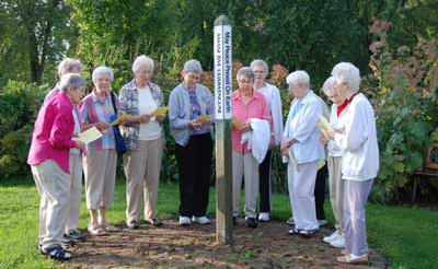 Sisters gathered around the Peace Pole in Mankato, Minnesota, to celebrate the International Day of Peace.