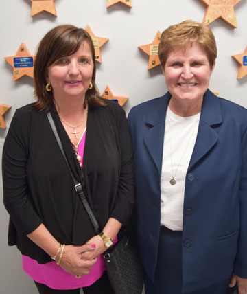 Donor Ann Kampeter and Sister Kathleen Wegman stand in front of the donor wall at the SSND North American Archives during the dedication and open house held Saturday, June 2, 2018.