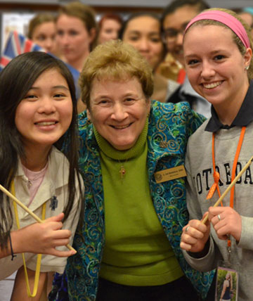 Photo of Sister Janise Berberich with two Notre Dame High School students.