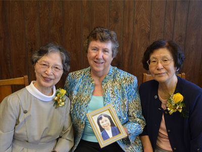 Sisters Joanna Suh, Mary Anne Owens and Mary Eileen Nakamura hold a photo of Sister M. Judith Kamada, who was not able to travel to St. Louis to be part of the 2016 Jubilee celebration.