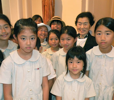 Sister Beatrice Tanaka, Principal, Notre Dame ElementarySchool, Kyoto with students visiting in St. Louis in 2012.