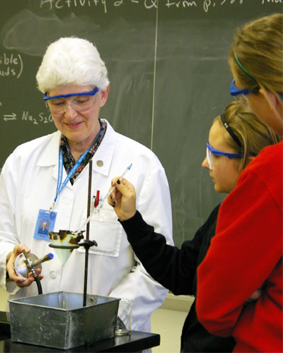 Sister Celine Schumacher teaches a science project to students at Notre Dame High School in St. Louis in 2017.