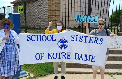 Notre Dame of Elm Grove, Elm Grove, WIsconsin, sisters participate in LCWR Region 9's campaign to speak out against racism. Featured: Sister Barb Linke on right, Associate Kate Fontanzza on left.