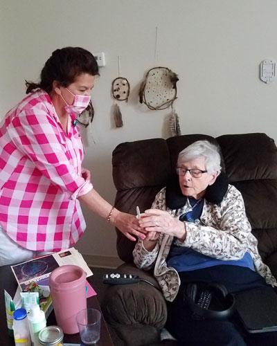 Sondra Arntzen, Activities Director is helping Sister Cele Schueller at Our Lady of Good Counsel, Mankato, Minnesota.