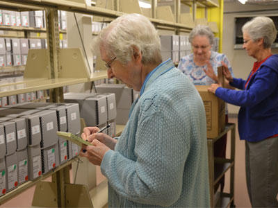 Sisters in St. Louis packed up the archives to send to their new home at Mount Mary University in Milwaukee. Sister Carol Marie Wildt goes through each archived folder.