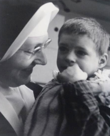 A photo of Sister Marie LeClerc with young boy student