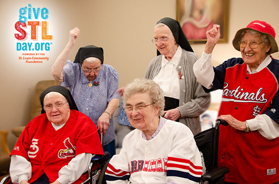 A group of sisters at The Sarah Community, posing for pictures in their St. Louis Cardinal attire for Give STL Day.
