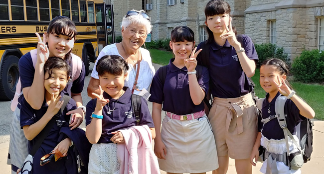 Notre Dame of Kyoto Children's choir with S. Anne Arthur Klinker leaving Mount Mary University for a tour of Milwaukee.