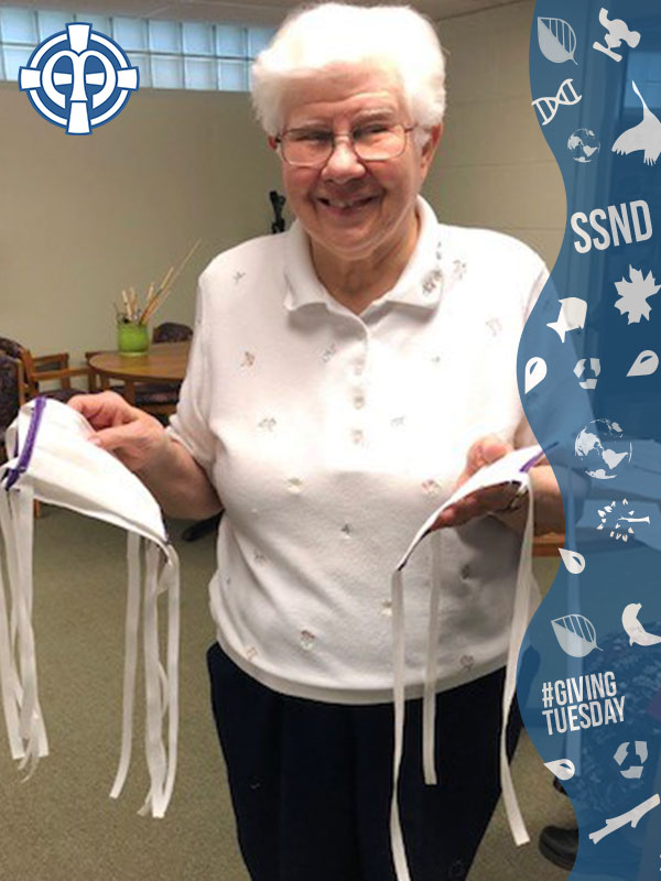 Sister Annora Polega shows off the finished masks made at Notre Dame of Elm Grove, Elm Grove, Wisconsin.