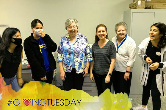 Sister Gloria Cain works with Catholic Charities in Dallas. This is an image of some of the staff there and Sister Gloria.