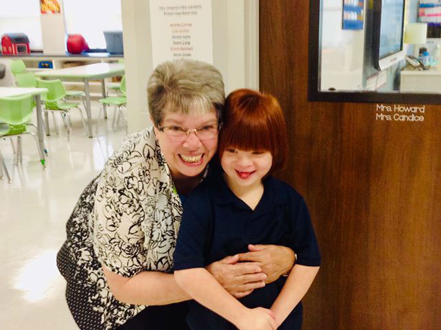 Sister Dawn Ach's posing with a student at Notre Dame of Dallas school.