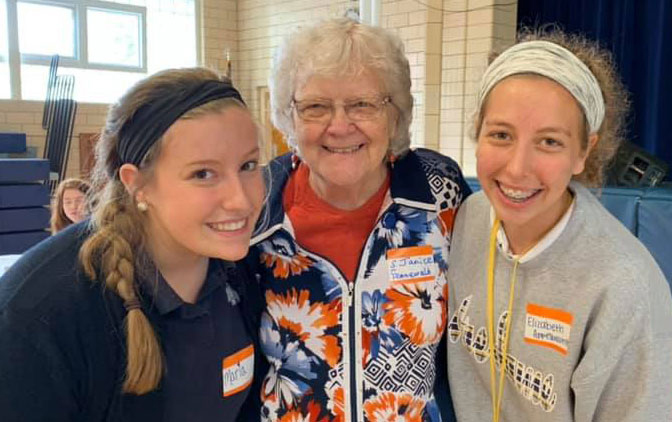 Two students from Noter Dame High School in St. Louis pose with Sister Janice Fennewald at a Nun Buddy breakfast. Sister Janice loves the Nun Buddy program becuase she has the opportunity to hear from the students on a regular basis.