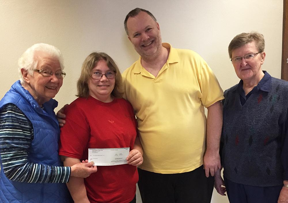 Our NoFest Octoberfest grand prize winner of $2,019, Kim and Will Decker.  Pictured with Sister Mary Jo Welter (left) and Sister Rose Marie Krebs (right).