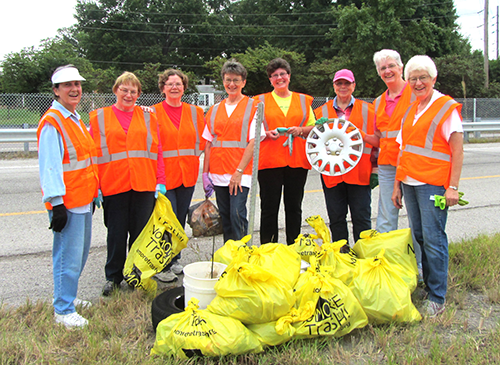 Standing with trash they picked up Aug. 29 are (left to right): Sisters Joan DiProspere, Linda Kramer, Jean Greenwald, Fran Dotta, Susan Renner, Pat Gravemann, Ruth Emke and Celine Schumacher.